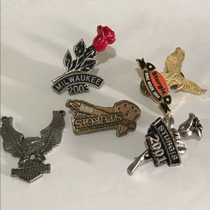 Set of five biker event pins.